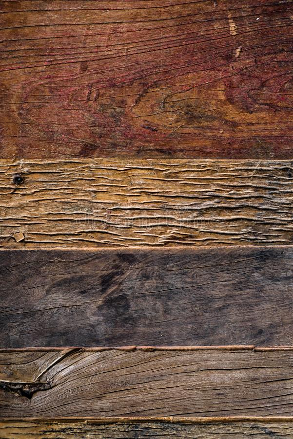 Aged wooden crannied planks background from above stock image