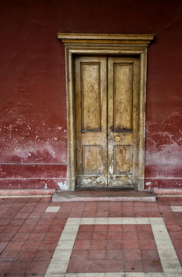 Aged wooden door of a historic house in the city of Copiapo. Chile stock photos