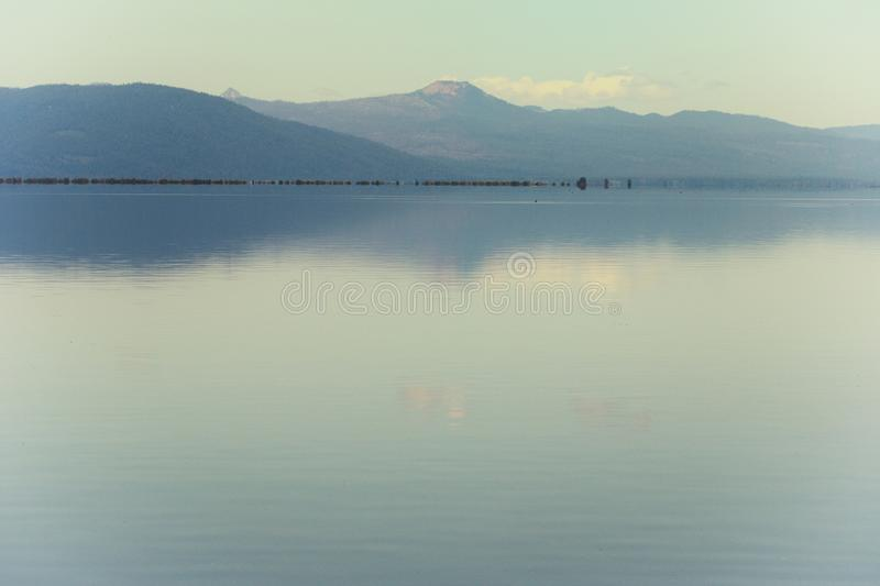 Perfectly still waters on mountain lake stock photo
