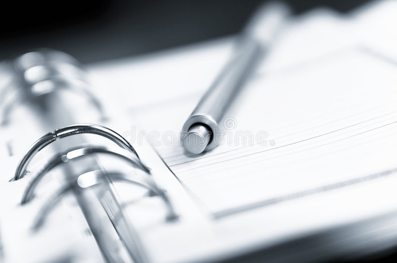Agenda and ball pen royalty free stock photos