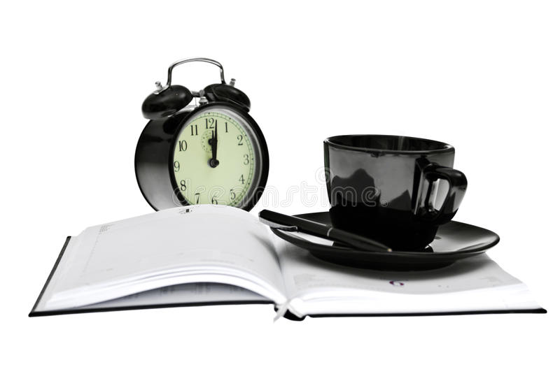 Agenda, coffee, clock and pen, office tools stock photography