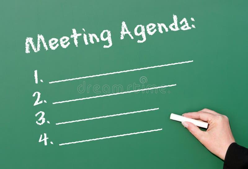 Agenda da reunião do quadro fotografia de stock royalty free