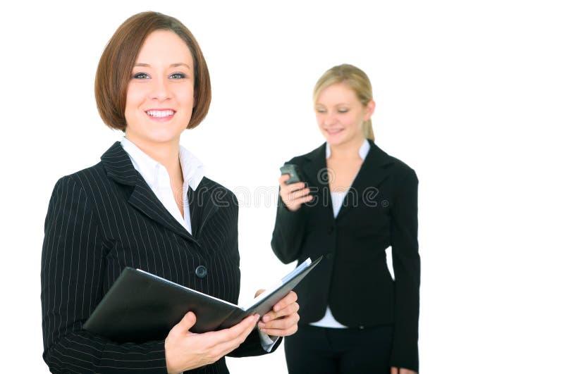Agenda de sorriso da terra arrendada da mulher de negócios imagem de stock royalty free