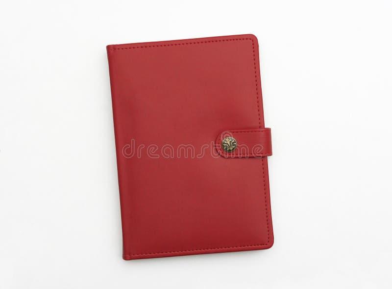 Agenda en cuir rouge de cahier de tourillon images libres de droits