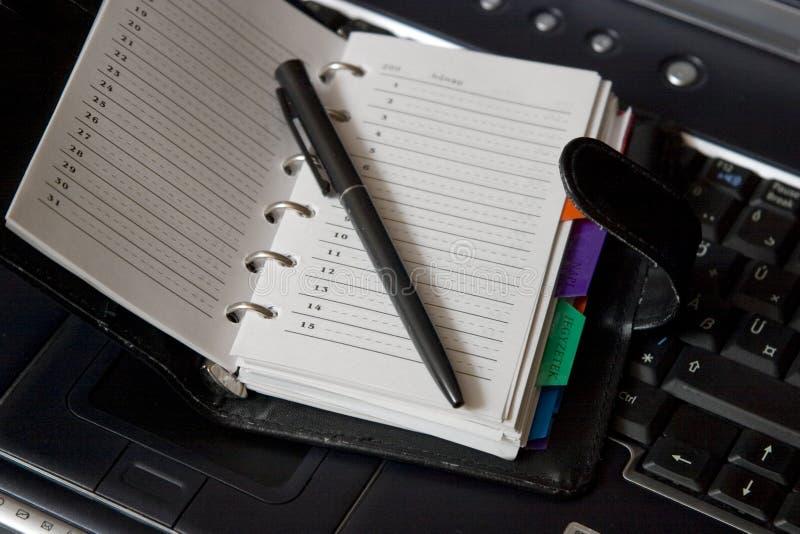 Agenda na laptop klawiaturze zdjęcia stock
