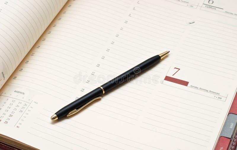 Agenda and pen stock photo