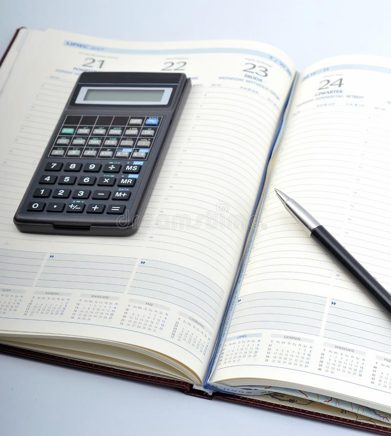 Agenda, pen and calculator royalty free stock images