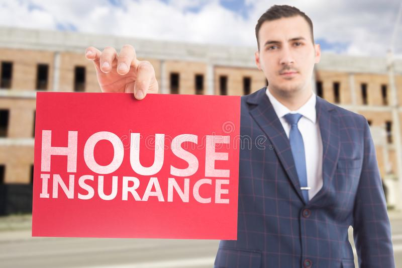 Agent advertising house insurance with paper stock photography