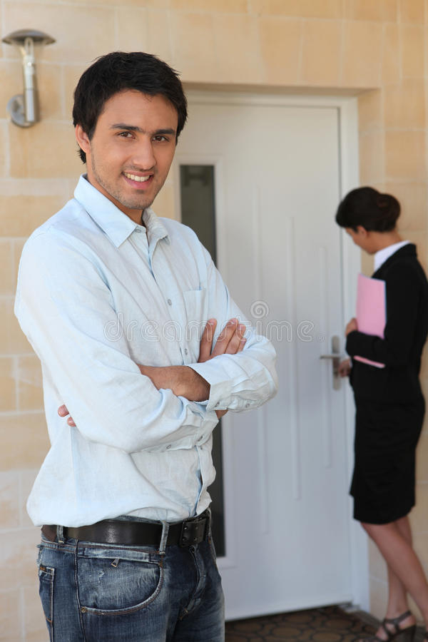 Agent with a buyer stock images
