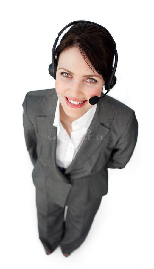 Agent confiant de service à la clientèle utilisant un écouteur photo libre de droits