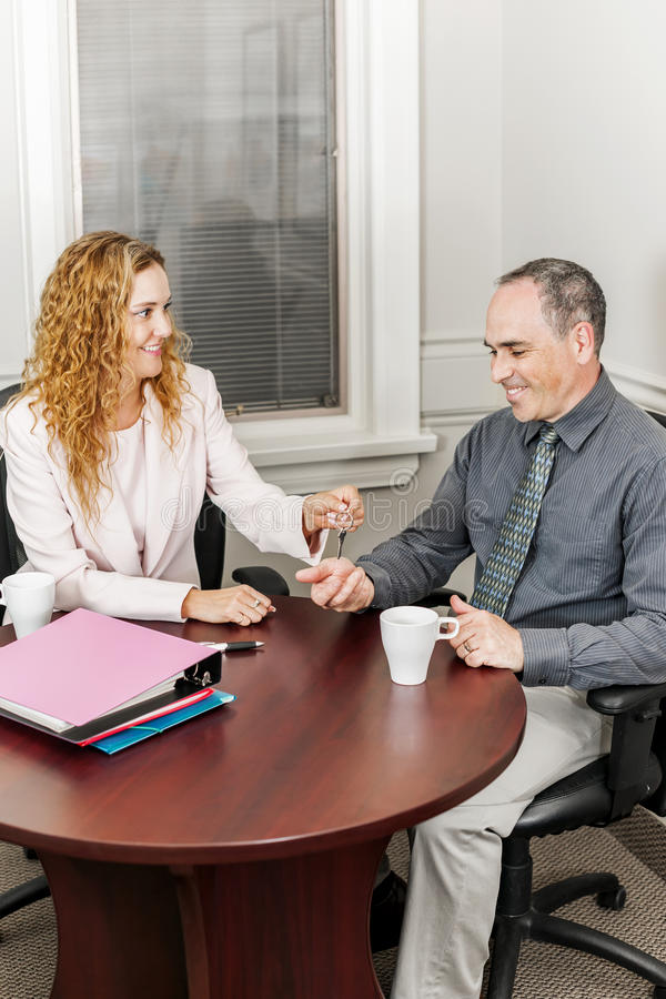 Agent giving keys to buyer stock images