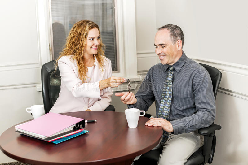 Agent giving keys to buyer royalty free stock images