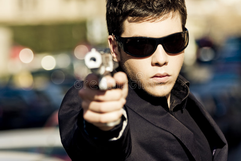Download Agent with gun stock photo. Image of pointing, agent, angry - 4677028