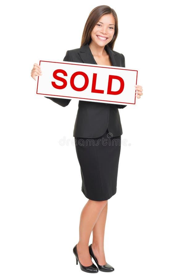 Agent immobilier réel d'isolement sur le fond blanc image stock