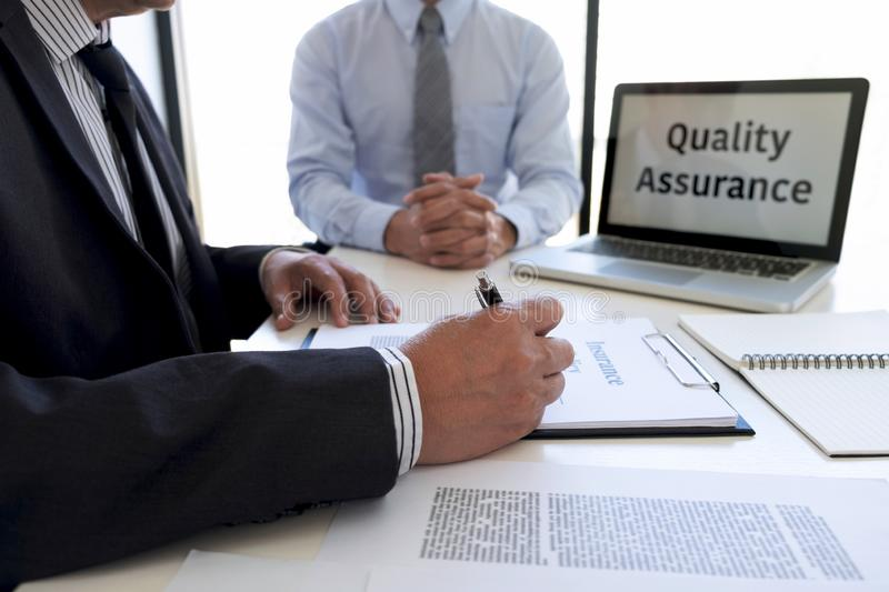 Agent man presentation and consulting life insurance detail to customer and waiting for his reply agreement to finish royalty free stock image