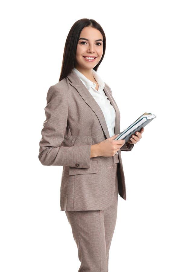 Agent nieruchomości z notatnikiem na biało zdjęcia stock