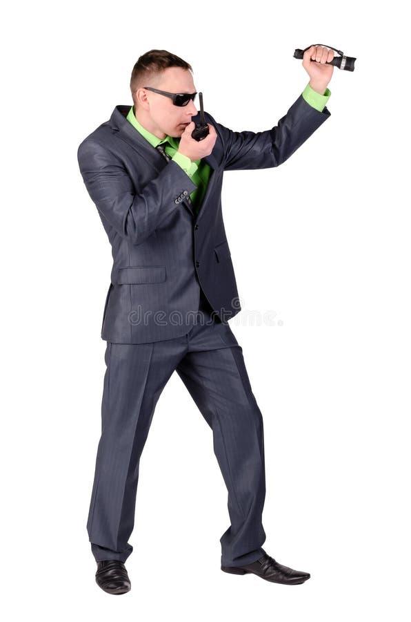 Agent ochrony opowiada na przenośnym urządzeniu odizolowywającym fotografia stock