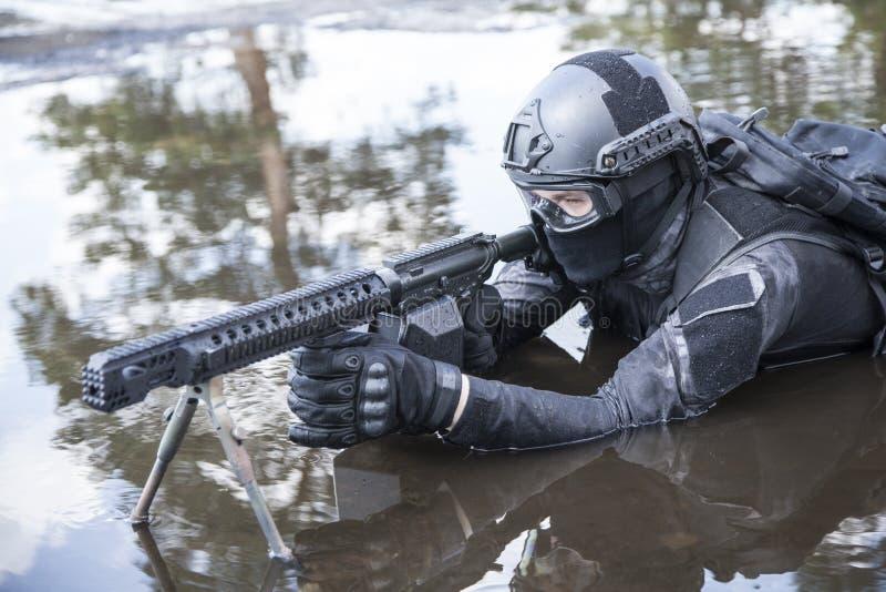 Agente da polícia dos ops das especs. fotografia de stock