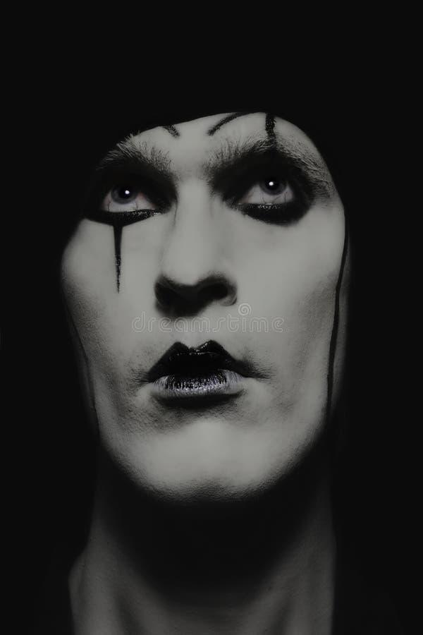 Agente de teatro con maquillaje oscuro foto de archivo