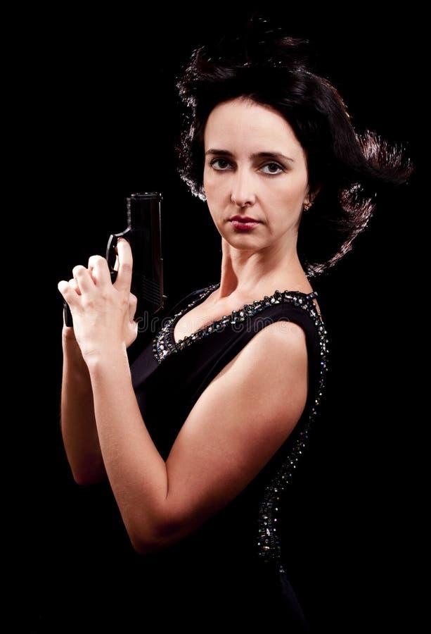 Agente di secrea della donna con la pistola fotografia stock