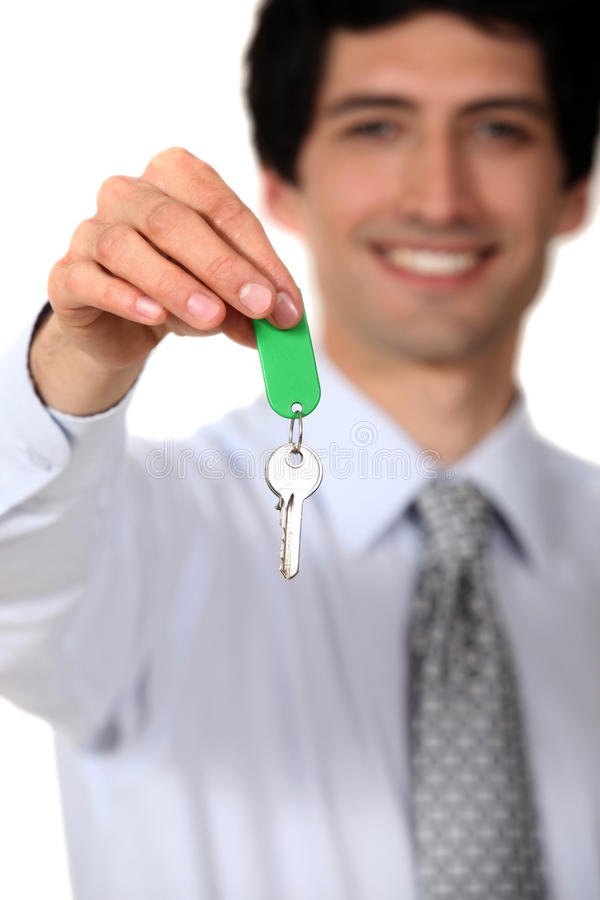 Agente imobiliário com uma chave fotos de stock