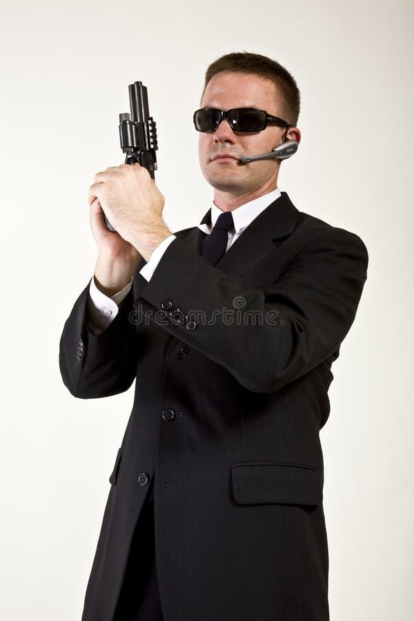 Agente secreto armado e perigoso fotografia de stock royalty free