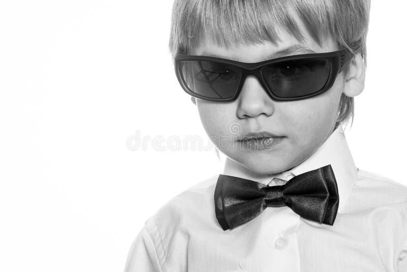Agente segreto il sogno di un bambino Bambino piccolo del signore immagine stock