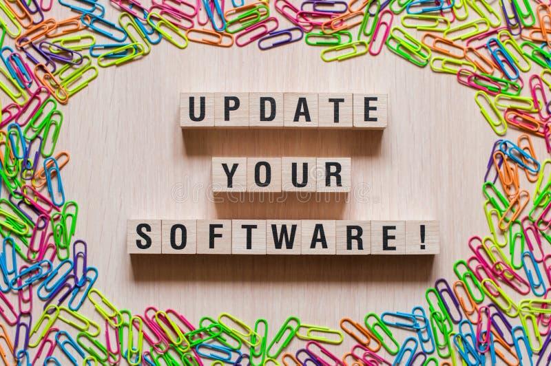 Aggiorni il vostro concetto di parola del software fotografia stock libera da diritti