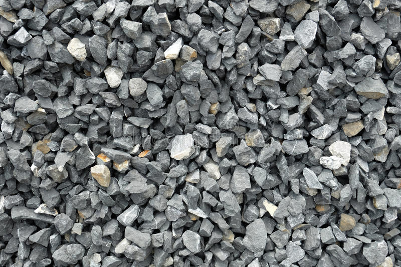 Aggregate Sizes Crushed Stone : Aggregate of coarse gray stones crushed at a stone pit