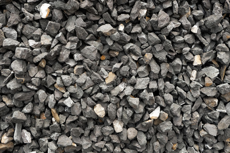 Aggregate of dark gray and coarse stones crushed at a stone pit - gravel pattern royalty free stock photography