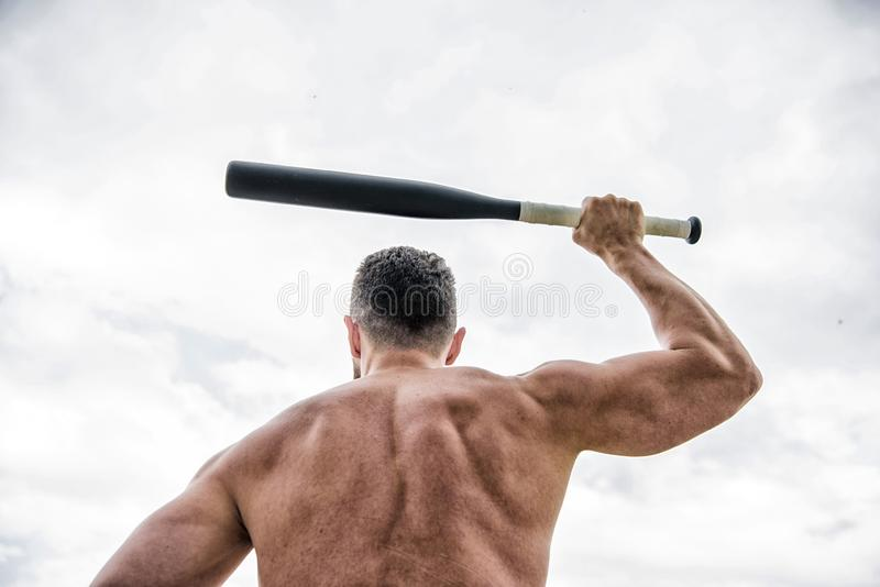 Aggression. muscular back man isolated on white. i am a criminal. Hooligan man hits the bat. Bandit gang and conflict. Aggression and anger. unshaven muscular stock image