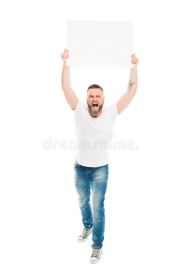 Aggressive bearded man holding blank banner above head,. Isolated on white royalty free stock images