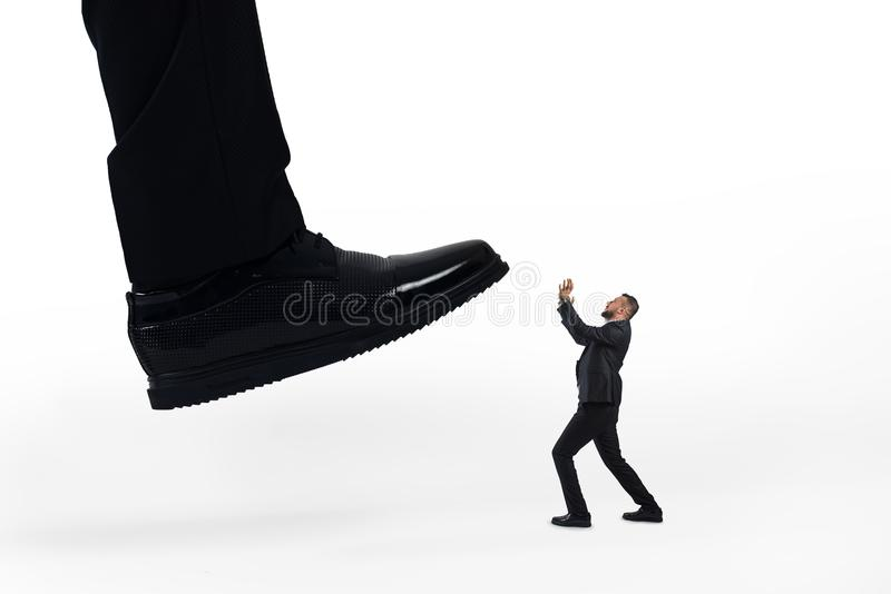 Aggressive boss with empoyee . Mobbing concept stock photos
