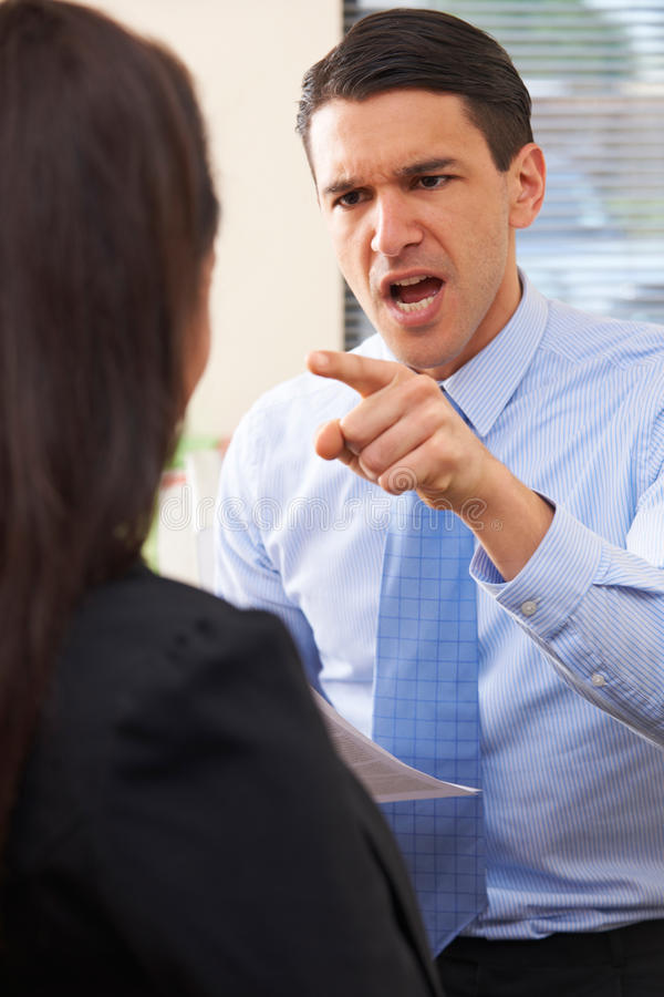 Aggressive Businessman Shouting At Female Colleague royalty free stock photography