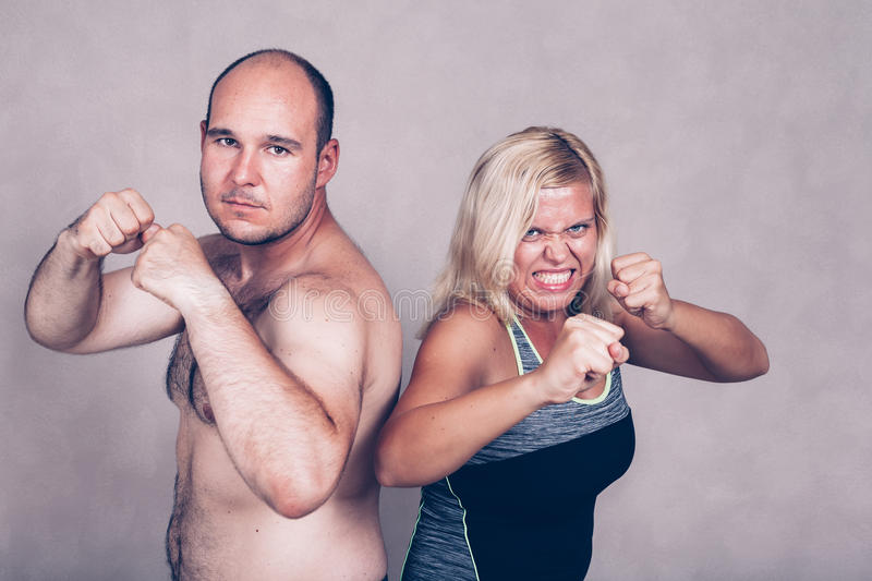 Aggressive couple ready to fight. Portrait of aggressive angry couple posing together, ready to fight stock photography