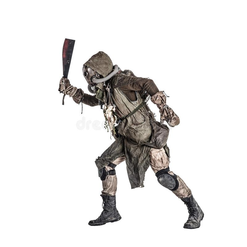 Post apocalyptic human threatening with cane knife. Aggressive and evil humanoid monster or creature of post apocalyptic, poisoned by dangerous pollution world royalty free stock photo