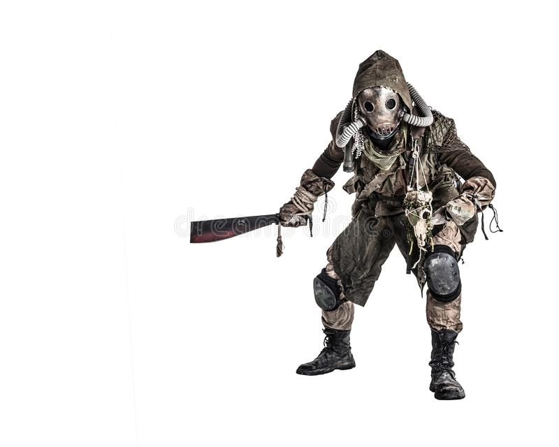 Post apocalyptic human threatening with cane knife. Aggressive and evil humanoid monster or creature of post apocalyptic, poisoned by dangerous pollution world stock images