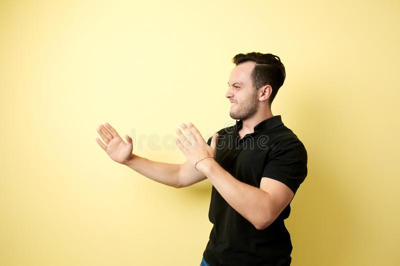 Aggressive guy dressed in the black t-shirt ready to fighting stock photos