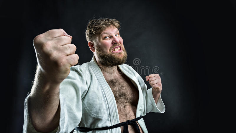 Aggressive karate fighter stock photography