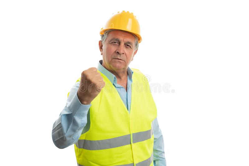 Construction worker holding fist up royalty free stock image