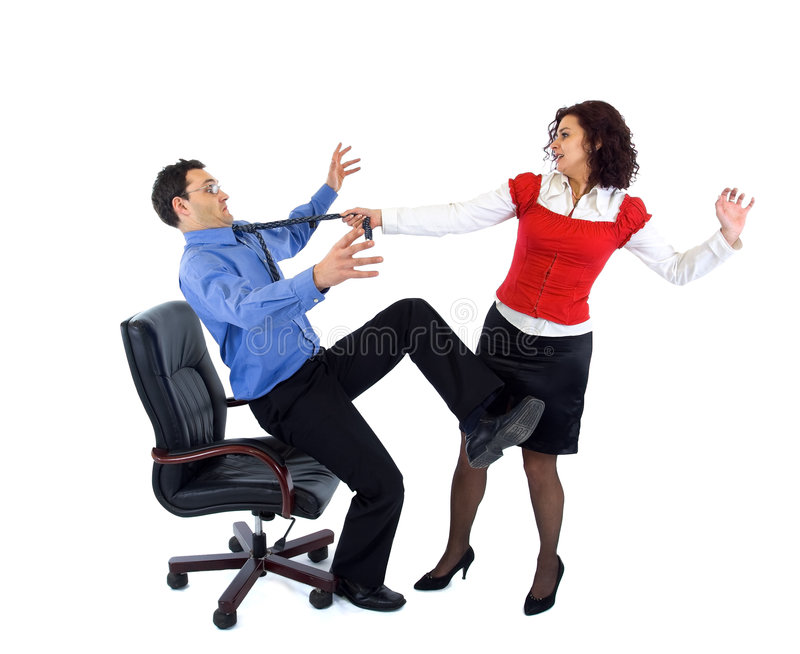 Aggressive secretary. Beautiful secretary woman wresting businessman from armchair by tie royalty free stock images