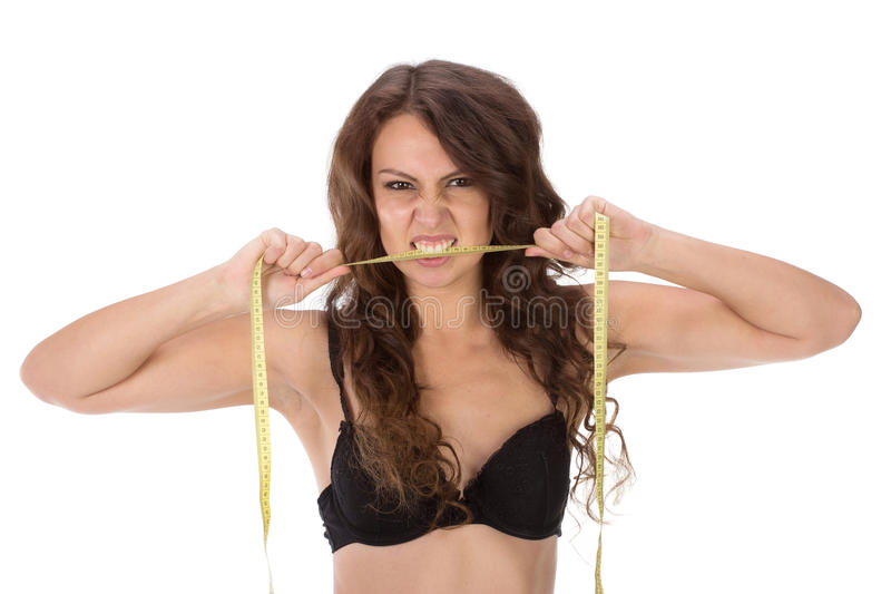 Aggressive slender beautiful girl. Isolated on white royalty free stock images