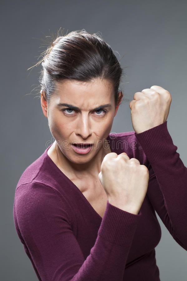 Aggressive sporty 30s woman showing her energy stock photo