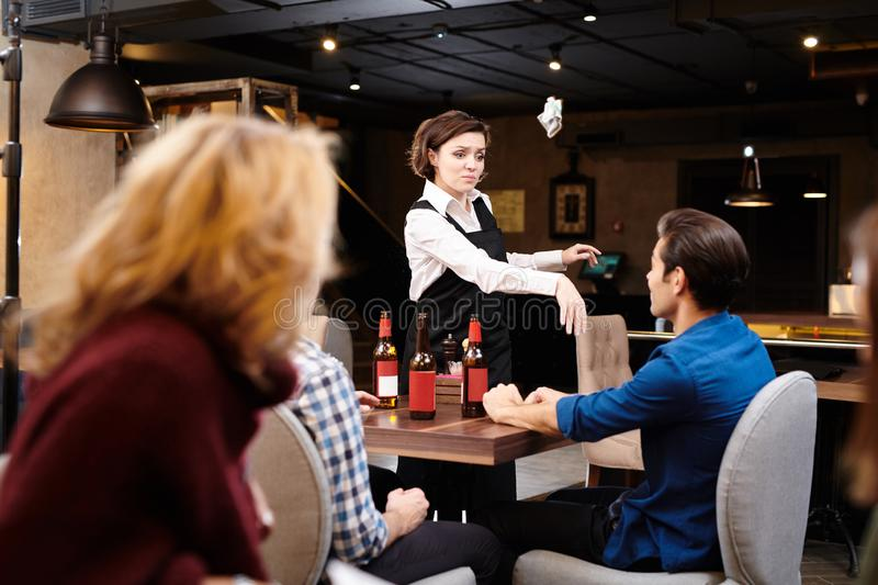 Aggressive waitress throwing money in guests face royalty free stock photography