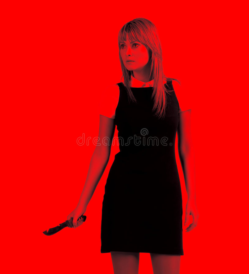 Aggressive woman with knife stock image