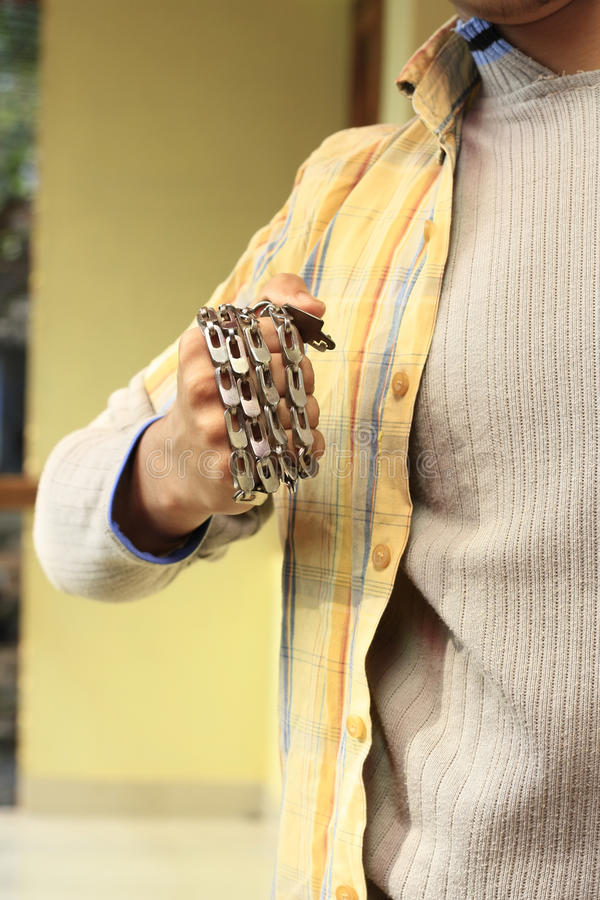 Download Aggressive Young Man With Chain Wrapped On Wrist Stock Image - Image of destroy, dangerous: 24585555