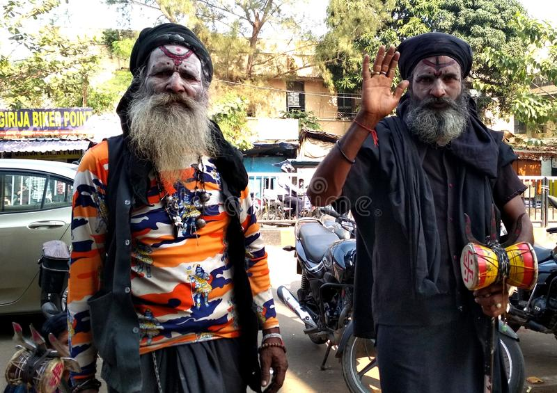 The Aghoris. The Aghori Sanskrit aghora are a small group of ascetic Shaiva sadhus. They engage in post-mortem rituals. They often dwell in charnel grounds royalty free stock image