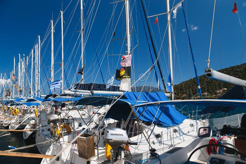 Agia Efimia, Cephalonia island, Greece - July, 14 2019: White yachts for rent against blue sky at a berth in Agia Efimia stock images