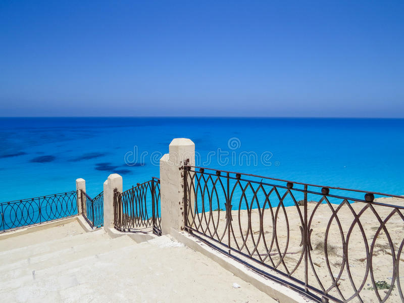Agiba Beach in Marsa Matruh. The sea near Agiba Beach is the most beautiful in Marsa Matruh.The colors of the sea are different shades of blue and green.The royalty free stock photo