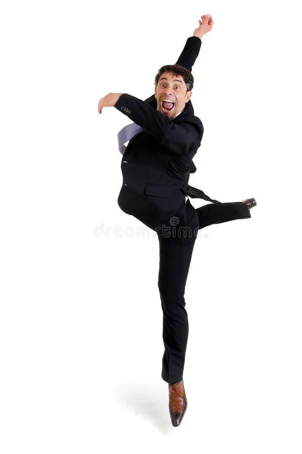Agile businessman doing a pirouette stock photos